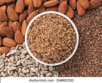 Homemade LSA mix in plate - Linseed or flax seeds, Sunflower seeds and Almonds. Traditional Australian blend of ground, source of dietary fiber, protein, omega fatty acids.Copy space for text.Top view