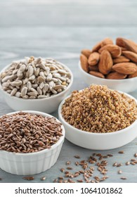 Homemade LSA mix in plate and Linseed or flax seeds, Sunflower seeds and Almonds. Traditional Australian blend of ground, source of dietary fiber, protein, omega fatty acids. Copy space for text.