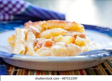 Homemade macaroni and cheese with bacon and onions