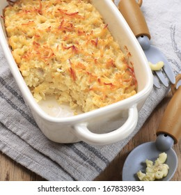 Homemade Macaroni and Cheese  for Kids. Made from Macaroni and Shredded Cheese, Served on Cream Baking Dish