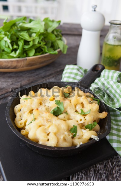 Homemade macaroni and cheese in rustic iron cast skillet