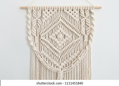 A Home-Made Macrame Wall Decor Display Hanging on a Wooden Dowel. Macrame Design Pattern.