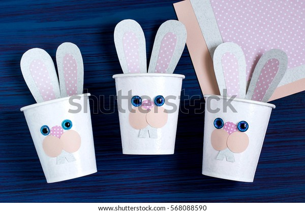 Homemade making of boxes from paper cups for sweets and candy in form of Easter hare. Present children. DIY concept. Step by step photo instructions. Step 6. The final result