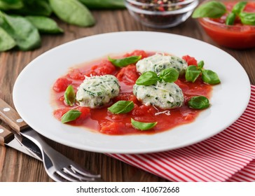 Homemade malfatti with tomato sauce, Italian dish of spinach, flour and cheese