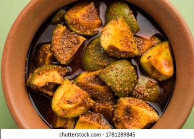 Homemade Mango Pickle or Aam ka Achar in a bowl, selective focus