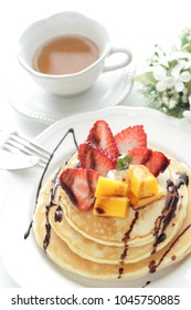 Homemade mango and  strawberry pancakes