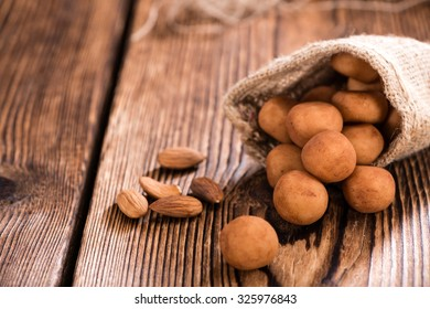 Homemade Marzipan Potatoes (German cuisine) on rustic wooden background