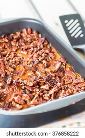 Homemade Mashed Sweet Potato Casserole with Caramelized Pecans for Thanksgiving Day, Vertical, Close-up