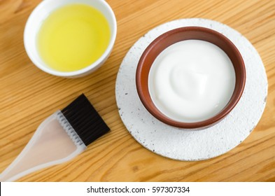 Homemade mask made of sour cream (greek yogurt) and olive oil. Diy cosmetics