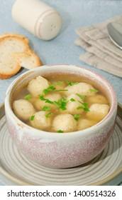Homemade matzo ball soup. Dumpling chicken soup