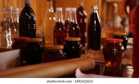 Homemade mead bottles on the shelf of an outdoor market. honey wine. homemade wine in georgia
