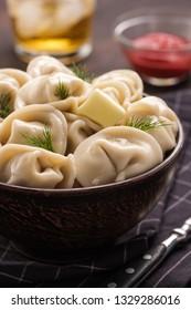 Homemade meat dumplings - russian pelmeni. Dumplings, filled with meat, ravioli. Dumplings with filling.