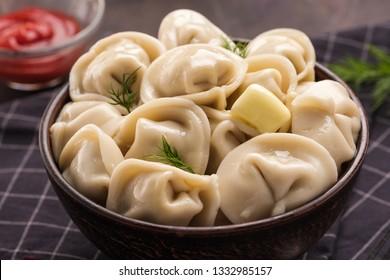 Homemade meat dumplings - russian pelmeni. Dumplings, filled with meat, ravioli. Dumplings with filling. Close-up.
