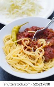 Homemade meat sauce served with pasta, feferoni.