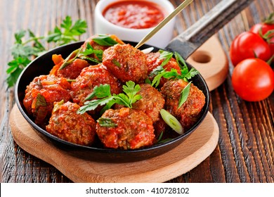 Homemade meatballs in tomato sauce.
