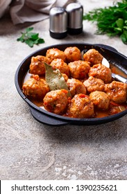 Homemade meatballs with tomato sauce in fry pan