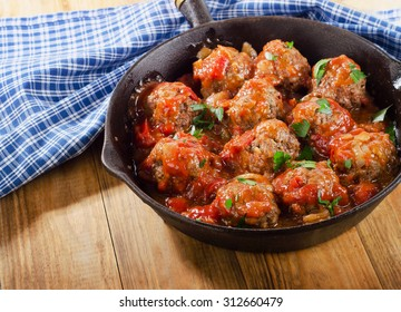 Homemade Meatballs with Tomato Sauce and herbs. Selective focus