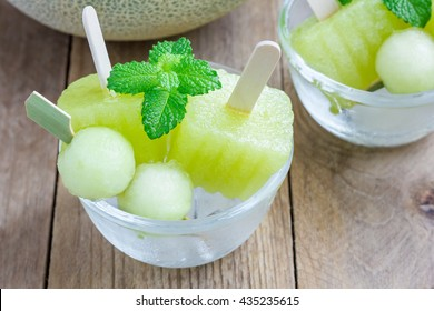 Homemade melon popsicles in the glass, closeup