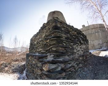 Homemade melting furnace. Masonry granite kiln of an old copper smelter