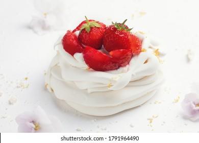 Homemade meringue dessert Pavlova cake with fresh strawberries and mint. Summer dessert. French cake. Confectionery. Classic dessert. Strawberry dessert