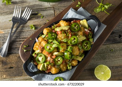 Homemade Mexican Tater Tot Nachos Tachos with Cheese Cilantro and Jalapeno