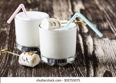 Homemade milkshake in glasses and top with toasted marshmallows