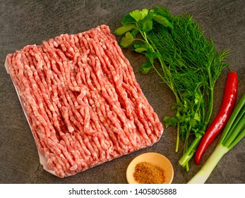 Homemade minced meat over dark slate or stone background
