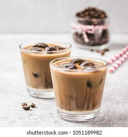 Homemade mocha coconut iced coffee on concrete background. Selective focus, copy space.