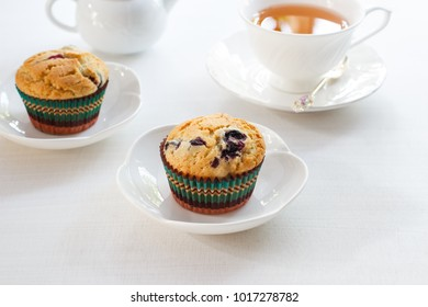 Homemade muffin with blueberry and cup of tea.