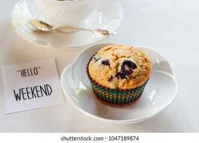 """Homemade muffin with blueberry and Text """"HELLO"""" WEEKEND."""