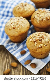 Homemade muffins  with almonds on the table