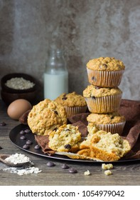 Homemade muffins with oats and chocolate drops (chips). The tasty muffins with chocolate.