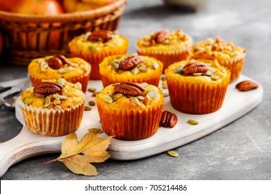 Homemade muffins of pumpkin with pecans. Autumn menu