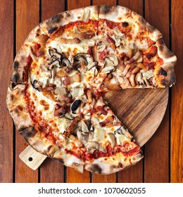 Homemade mushroom pizza on wooden dish delicious with crispy powder and grilled with wood baking oven.