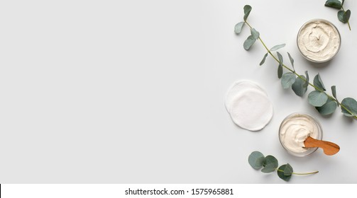 Homemade natural cosmetics. Organic creams with olive oil for face and body, white background, panorama, copy space