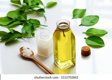Homemade natural herbal oral care product from  lemon leaves and salt boil with water make yellow mouthwash for dental hygiene, treatment bacteria in oral cavity, make fresh breath