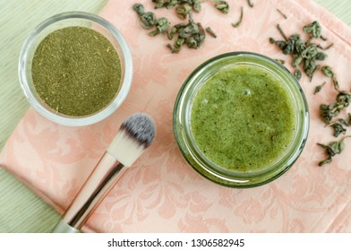 Homemade natural mask (scrub) with sea salt, olive oil and green tea. Diy cosmetics recipe. Top view, copy space