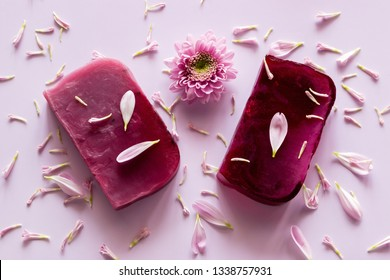 homemade natural soap on a colored background with flower petals