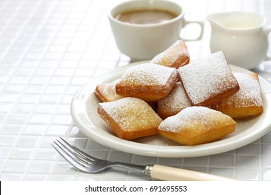 homemade new orleans beignet donuts and a cup of coffee