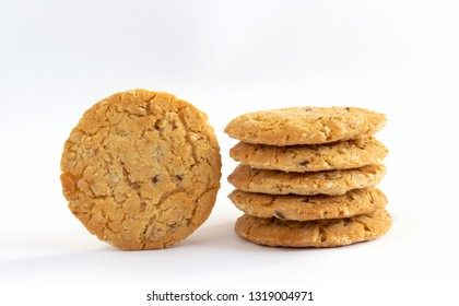 Homemade oat cookies stacked on white table background. Its are a nutrient-rich food associated with protein and fiber.