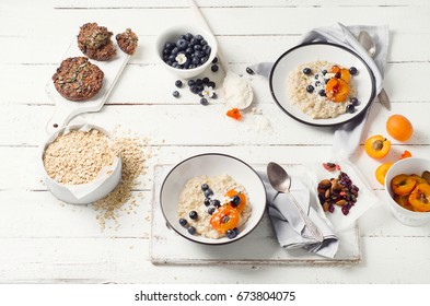 Homemade Oatmeal with bluberries and apricots. Healthy breakfast. Top view