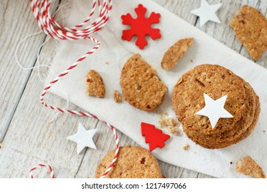 Homemade oatmeal cookies with christmas decorations top view