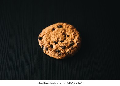 Homemade oatmeal cookies on the table, on dark background