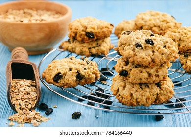Homemade oatmeal cookies with raisins on blue table.