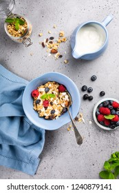 Homemade oatmeal granola or muesli with yogurt and fresh berries for healthy morning breakfast, selective focus. Healthy food background.
