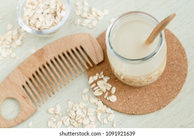 Homemade oatmeal hair cleanser and wooden hair comb. DIY oatmeal milk or toner for natural skin and haircare.