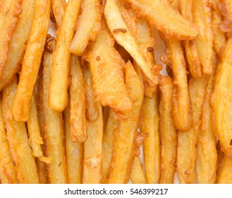 Homemade oil fried sweet potato fries on background