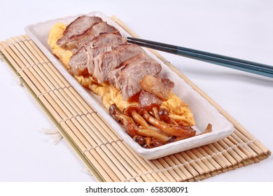 Homemade ,Omelet topped pork steak and grilled mixed mushroom in Japanese style.