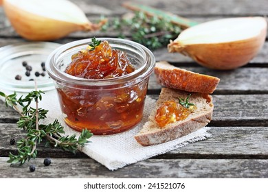 Homemade onion marmalade (jam) on a rustic wooden table.Selective focus.