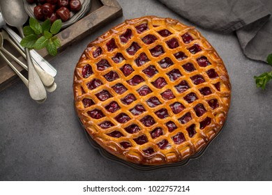 Homemade open sour cherry pie, delicious sweet dessert served on gray table top view
